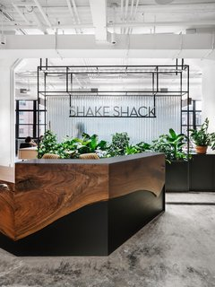 For the Shake Shack headquarters, plenty of greenery was a must. They wanted it to feel like a peaceful, wellness-focused space rather than a typical fast-paced hospitality company.