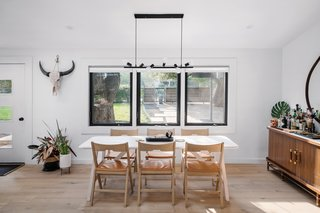 The simple dining room features a Landala table by Emma Olbers for Tre Sekel.