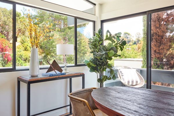 The dining room is flooded with natural light. The couple turned to stager Meredith Baer to outfit the area.