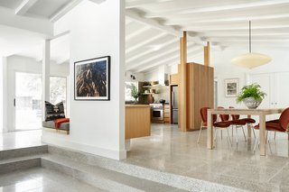 """When it hit the market, this 2,660-square foot, three-bedroom, two-bathroom home hadn't been updated in more than 60 years, but the homeowner saw its inherent charm and called on architects Rick and Cindy Black and Christina Simon of Mark Ashby Design for a complete renovation. Some of the biggest challenges included """"figuring out how to integrate the living room, which was once a carport that had been closed in at some point,"""" says Rick Black. """"A brick wall separated it from the other areas, and it was really a dead room."""" Another consideration was respecting the home's history and its bones and choosing an aesthetic that matched the homeowner's active lifestyle. Other updates included terrazzo flooring and built-in furniture."""