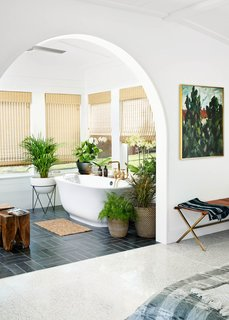 """The sunroom is off the master bath. """"The homeowner asked for a stand-alone tub,"""" Simon says. """"We've done them in the past, but never had a homeowner lead us to install one."""""""
