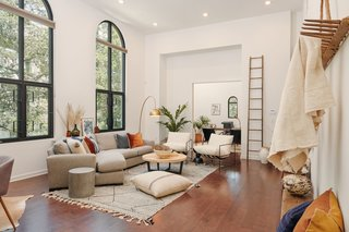 Staged by local interior design company Loot Rentals, the modern home references the building's past via arched windows.