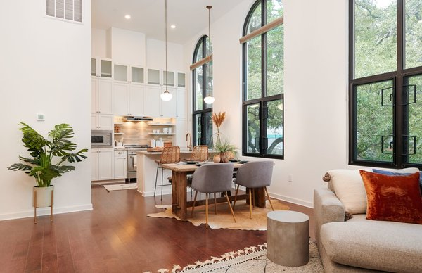 The building is 6,500 square feet, so each loft feels spacious and airy. The arched windows, which rest in the original openings, let in light and views of the adjacent oak sanctuary.