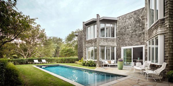 The backyard, which Lauren Rottet completely remodeled with new landscaping and a heated saltwater pool, is the ideal spot to relax on a balmy New England summer day.