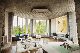 "The hexagonal living room includes an Irving Harper and George Nelson Marshmallow Sofa, Rottet's Bent Metal Rectangle Cocktail Table in polished stainless steel, and Kiki Smith's Self-Portrait. ""The Kiki Smith piece I had rolled up,"" she says. ""I had never had the opportunity—or high-enough ceilings—to hang it before."""