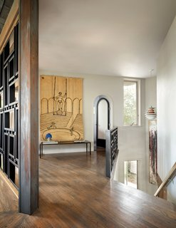 The upstairs hallway, which leads to Rottet's master bedroom, displays an 1969 Alexander Calder woven wall tapestry.