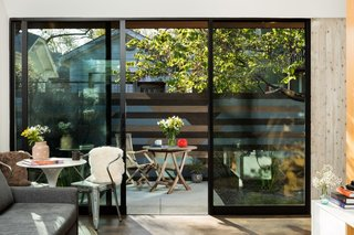 The guesthouse is intentionally pushed back in the homeowners' backyard to create a feeling of privacy and seclusion.