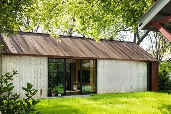 """Ravel Architecture partners Alex Finnell and Devin Keyes chose board-formed concrete for the exterior, scoring the vertical boards to """"get a really nice texture and interesting dynamics,"""" says Finnell."""