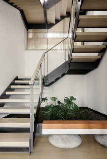 With white oak treads and a steel-and-glass railing, the new staircase is much more elegant.