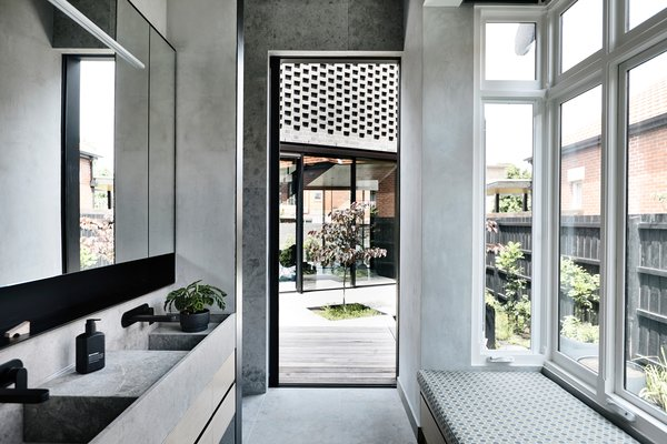 From the master bath, the homeowners have easy access to their main living spaces and this private courtyard.