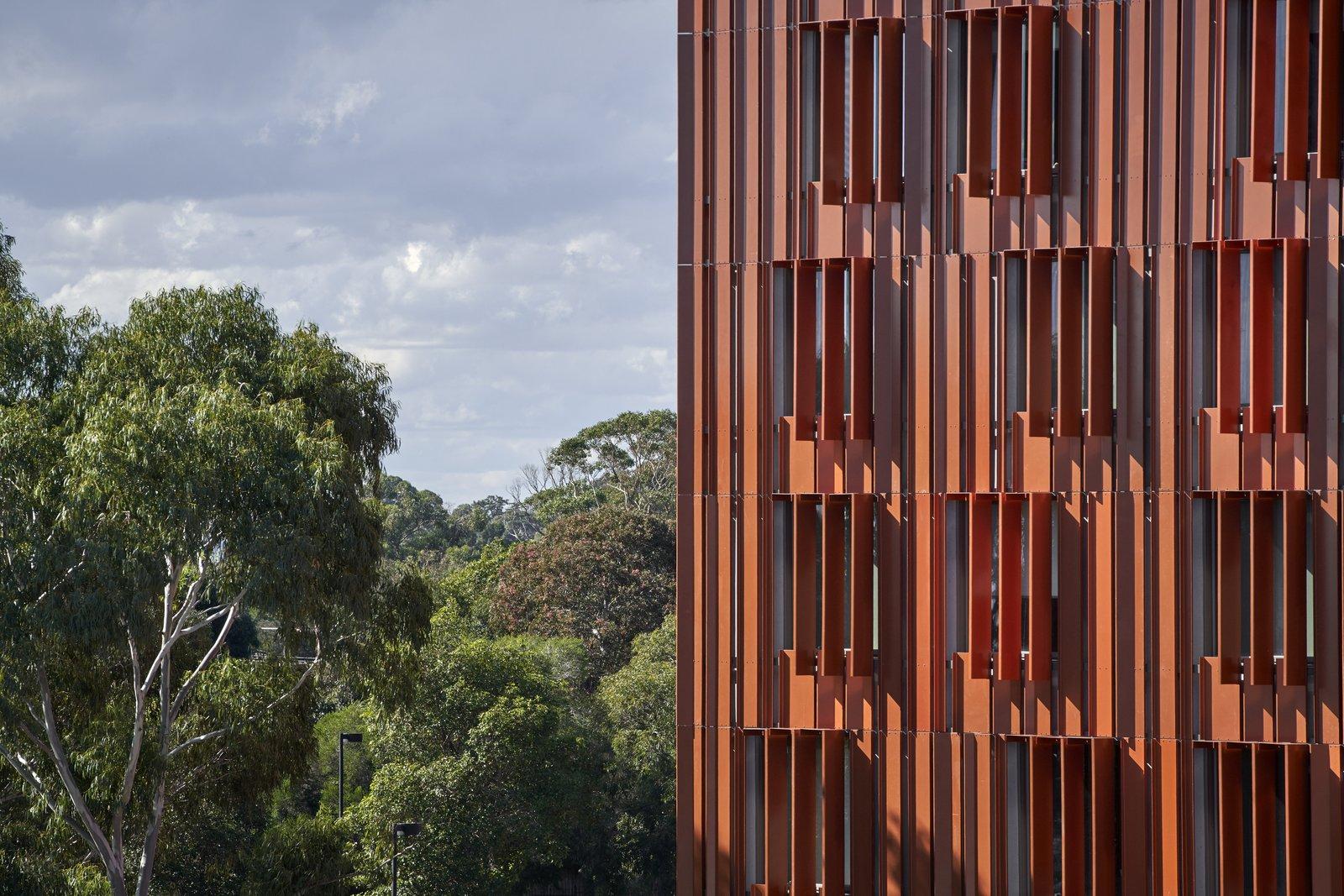 Gillies Hall at Monash University by JCB Architects orange steel sunscreen