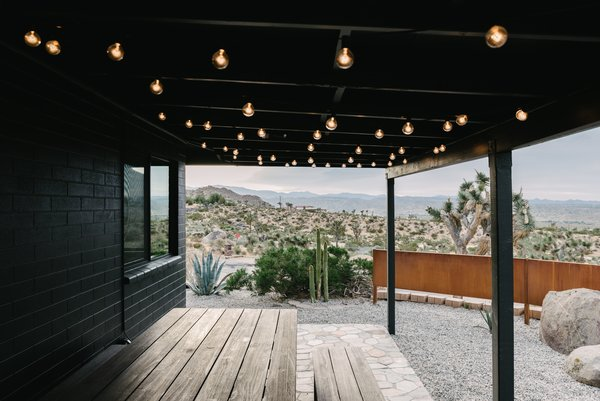 "When the couple purchased the home, there was no landscaping besides some local shrubs and Joshua trees. They decided to give the backyard a calming vibe with a saltwater hot tub. ""It's an invigorating experience, showering and soaking under an open sky so close to nature,"" she says. The saltwater uses fewer chemicals than chlorine, and helps relieve swelling and aching joints for hikers."