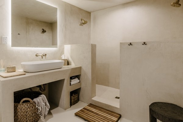 The guest bathroom was enlarged and finished with Moroccan plaster.
