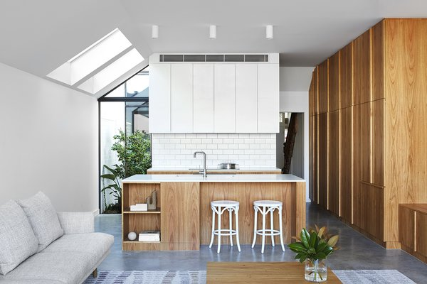 Harding went for simplicity in the kitchen, which features white backsplash tiles from Ceramica Vogue, a Ceaserstone countertop in Pure White, a Blanco sink with a Milli Inox fixture, and suface-mounted lights.