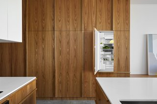 Harding went for Fisher & Paykel appliances, which disappear behind a wall of Tasmanian oak joinery.