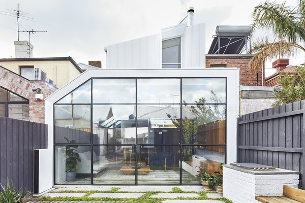 """Steel-framed glass doors provide plenty of natural light. Harding took extra steps to ensure that the house was properly insulated. """"We aren't great at thermally designing houses in Australia,"""" he says."""
