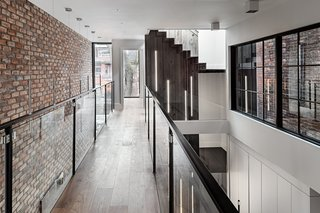 The second-floor landing has unobstructed sight lines to the street and enjoys natural lighting.