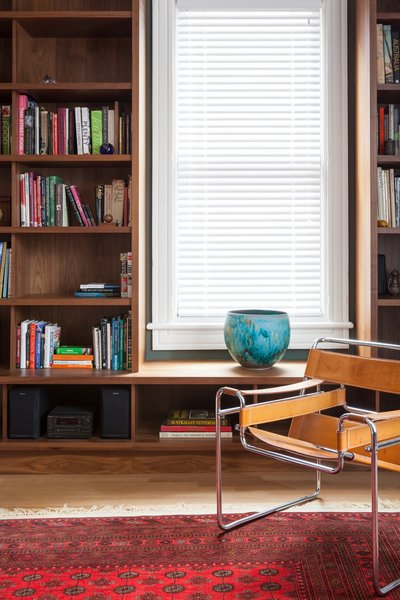 The library features furniture from the homeowners' collection—including this Marcel Breuer chair.