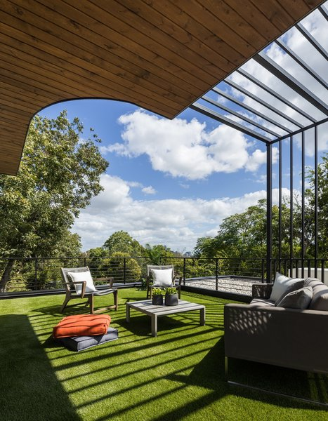 This home embraces indoor/outdoor living with ease thanks to oversized sliding glass doors, rooftop patio and design that elevates the second floor into the tree canopy.