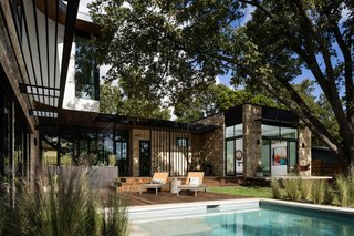 The backyard is the family's gathering space, with each room opening up to the courtyard.