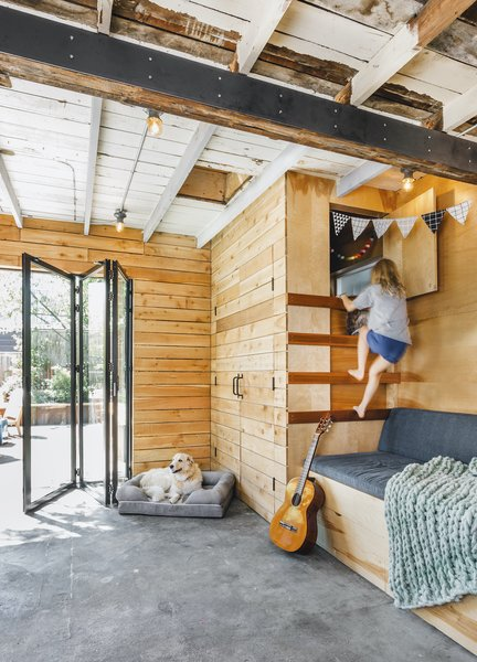 The original run-down shed wasn't very functional: The roof leaked, the carpet had sprouted mold, and the narrow quarters were sectioned off as two parking spots and two office spaces. So Ella engaged Mutuus Studio to help figure out an optimal design for the 360-square-foot shed—one that would encompass garden shed, exercise room, office, playroom, and outdoor dining space all while staying within a modest budget of less than $40,000.