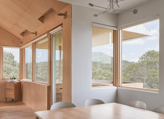 Thoughtfully placed windows provide gorgeous views. The treetops inspired the Gunnings' name for the home, Tree House.