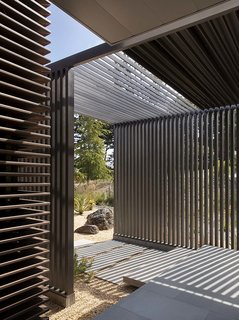 """The siding slides into the Louvre system and create a magical presence throughout the course of the day, but was quite the challenge to install as no contractors in the area had ever worked with it before. """"We had the factory pre-cut and pre-drill every piece so the whole house basically came pre-packaged."""""""