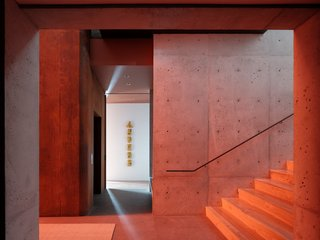"""The red glass started as an """"idea from the client that grew into this thing that was more powerful than we ever thought,"""" Faulkner says."""