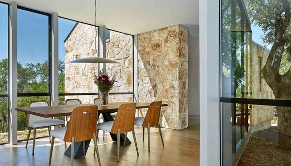 """In order to protect an adjacent root system, the architects cantilevered the dining room. This solution allows the """"roots to breathe,"""" Nance says."""