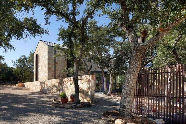 """The property, which is a good 10-15 minutes from the center of San Marcos, """"is at the end of a dead-end road and has this remote feeling. They really wanted a home that felt connected to nature and a place where they could enjoy the mountain laurels and views,"""" Nance says."""