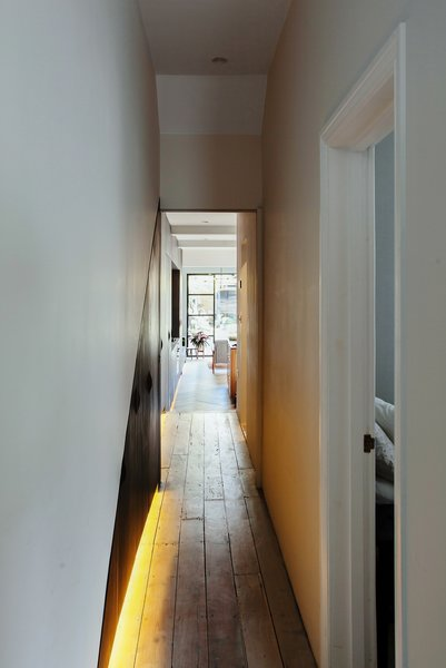 Initially, the dated Victorian lacked natural light, the halls were cramped, and the clients wanted to be able to see all the way to the garden upon entering.