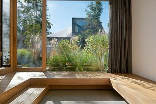 The conversation pit provides an intimate view of the garden and backyard art studio.