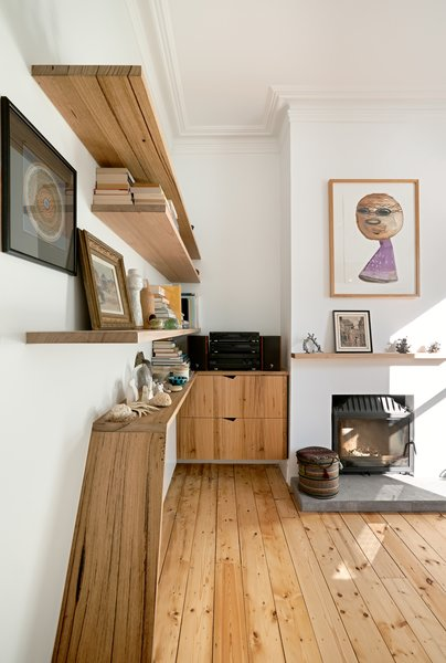 Recycled timber shelves stretch from the front hallway into the living areas, linking the old and the new.