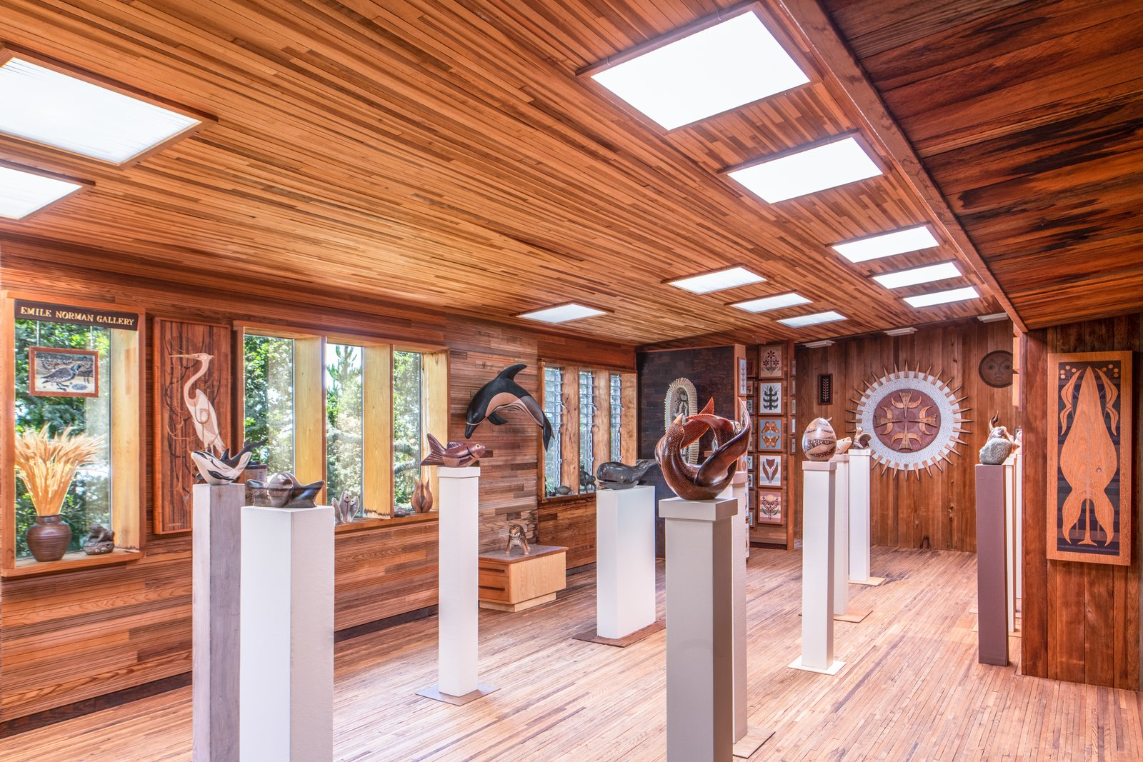 Office, Study Room Type, Shelves, and Light Hardwood Floor Emile was known for his sculptural work and the commissions he worked on for the Masonic Temple in San Francisco.  Photo 4 of 10 in Renowned Artist Emile Norman's Sensational Big Sur Home Lists for $2M