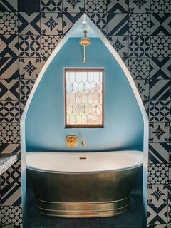 Architectural styles blend in this guest bath painted Eames for Blue by Dunn Edwards.