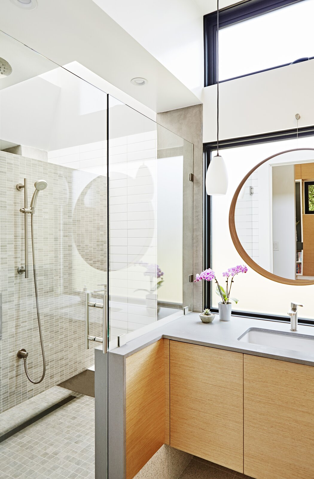 "Bath Room, Drop In Sink, Enclosed Shower, and Ceramic Tile Wall Another ask? The couple wanted separate showers. While the architects thought it would  be difficult to pull off, they were able to thanks to a floating wall ""which gives a sense of privacy and skylight,  Photo 6 of 8 in Budget Breakdown: This Sunny 1939 Santa Monica Bungalow Shines After a $765K Remodel"