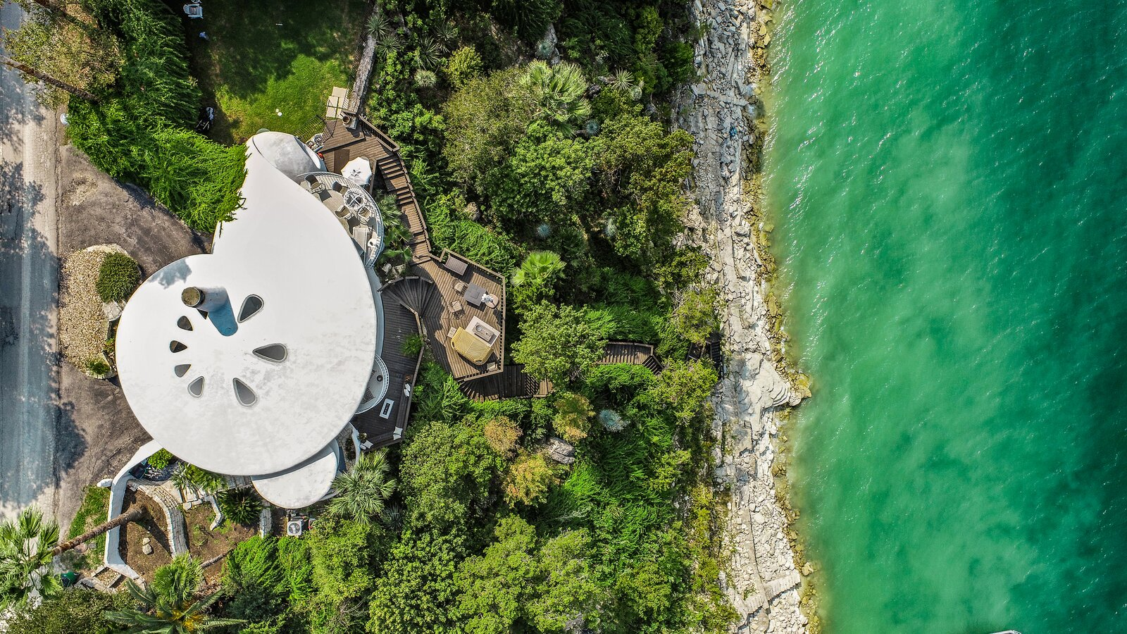 The home has three bedrooms, two full bathrooms, and a half bath.  Photo 3 of 7 in Austin's Weird and Wonderful Sand Dollar House Can Be Yours for $2.2M Clams