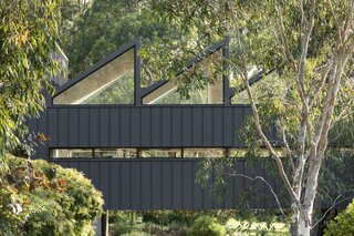 Located on a 19-acre working farm, CLT House pays homage to typical agricultural language with its pitched roof.