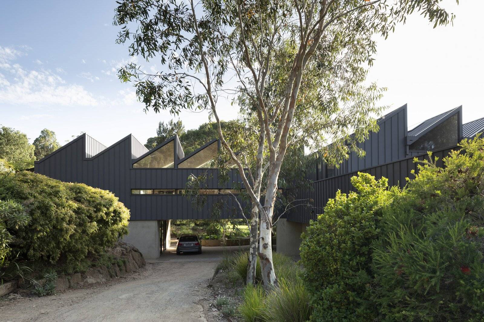 CLT can't be exposed to weather and water so another material, dark matte Colorbond steel, was used for the dramatic facade.  Photo 2 of 7 in Cross-Laminated Timber Gives This Renovated 1970s Australian Farmhouse a Bold Look