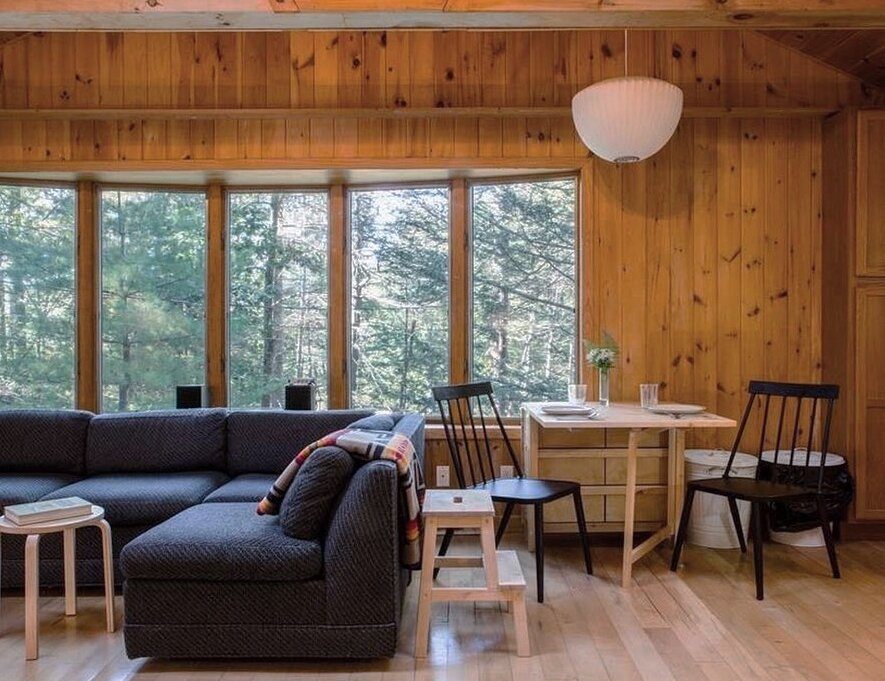 Dining Room, Table, Pendant Lighting, Chair, and Light Hardwood Floor Before: The dining space was awkwardly shoved into the main living room.  Photo 10 of 16 in Before & After: A Creative Couple Revive a 1950s Cabin in the Catskills