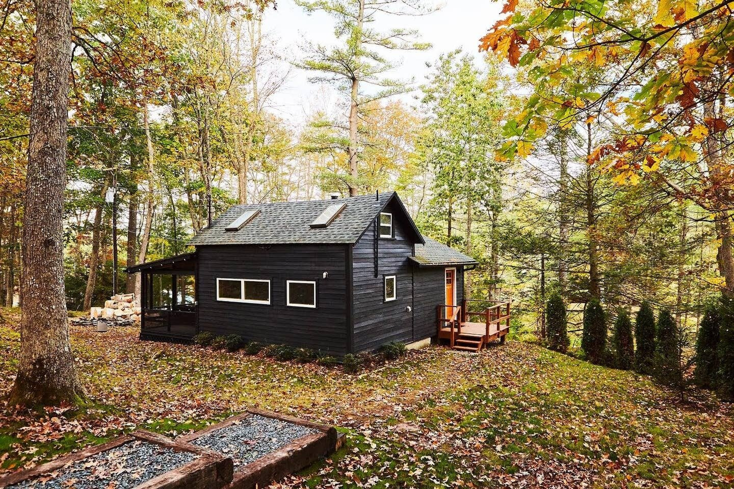 Highland Bungalow by Lauren Wesley Spear black cabin exterior