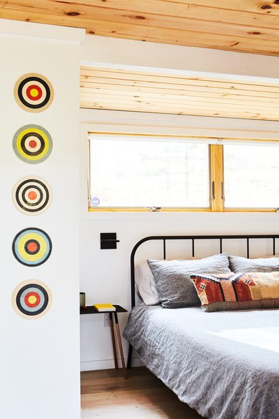 """The main bedroom suffered from lack of light, and the stairs were semi-exposed, which was strange. The team enlarged the windows and decided to keep the drywall here for better soundproofing. """"Tongue-and-groove tends to have cracks and openings, so this keeps it more private and insulated,"""" says Lauren."""