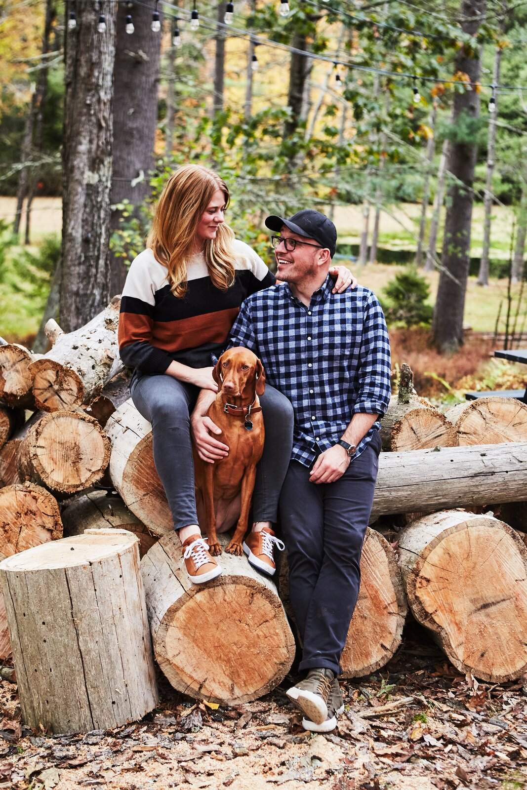 Outdoor, Back Yard, Boulders, and Trees Designer and architect Lauren Wesley Spear, creative director Michael Goesele, and their four-year-old Vizla named Bernese found a weekend retreat in the Sullivan Catskills.   Photo 2 of 16 in Before & After: A Creative Couple Revive a 1950s Cabin in the Catskills
