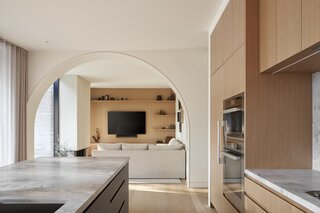 Instead of creating a super modern house, the archways and materiality brought warmth and character.