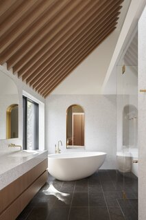 Wooden beams show off the 18.5-tall ceiling in the master bathroom.