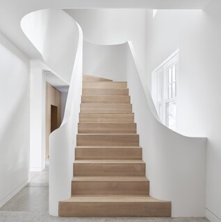 The stairs are one of the best parts of the renovation and were assembled on-site, stretching from basement to the top floor.