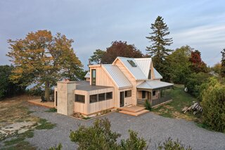 The Renovation of a Canadian Farmhouse Uncovers a Log Cabin Hidden Inside