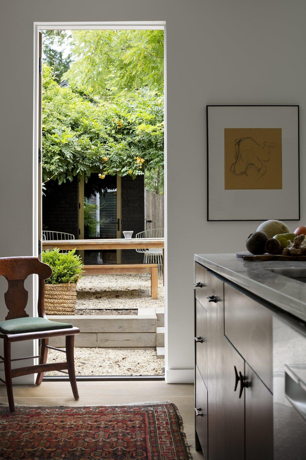 Kitchen, Engineered Quartz Counter, and Medium Hardwood Floor New Exterior connection via Kitchen  Best Photos from Albemarle Addition / Renovation