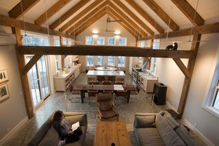 Exposed hemlock beams form a series of proscenia that distribute the roof load.