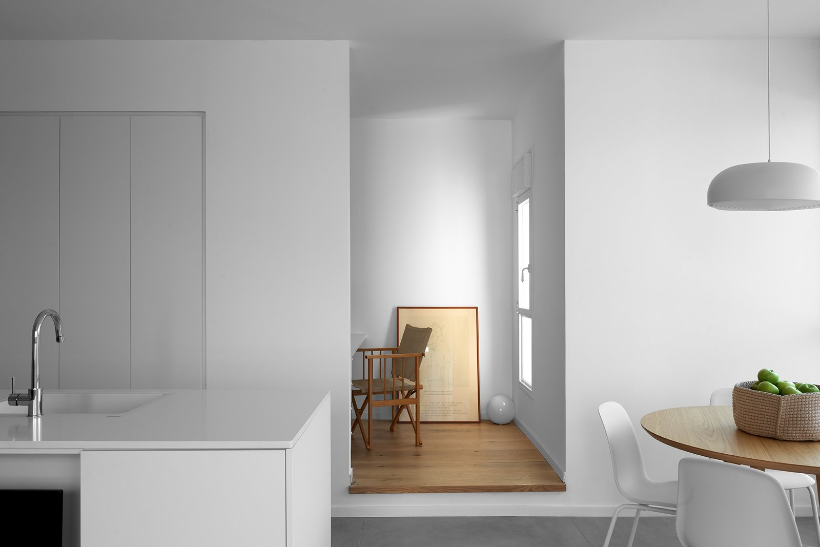Apartment Renovation in Haifa by Michael Peled Architecture Studio kitchen and raised office nook